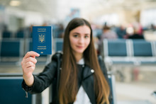 Young Happy Woman Holding Ukraine Passport In Terminal Of Airport