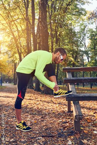 Photo sur Aluminium Graffiti collage Preparing for jogging in autumn colored park.