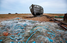 Old Abandoned Boat On The Beach In Dungeness UK