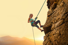 Beautiful Woman Climbing On Th...