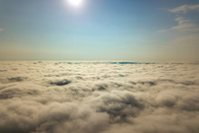 Aerial View Over White Clouds And Clear Blue Sky.