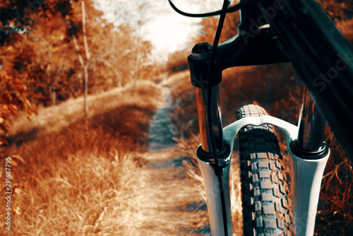 Photo  Mountain bike background. Mtb front wheel and fork close-up