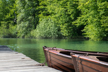 Wooden Boats On The Lake. Nature Green Surrounding. Shades Of Green. Travel And Relax.