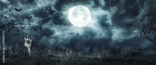 Zombie Rising and hands Out Of A Graveyard cemetery scary In Spooky dark Night full moon Wallpaper Mural