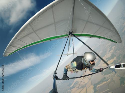 Hang glider pilot flies on high altitude. Canvas Print