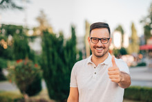 Portrait Of A Happy Man Showing Thumb Up Outdoors, Copy Space.