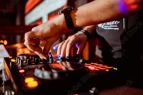 DJ in the club for the remote mixer - 291704788