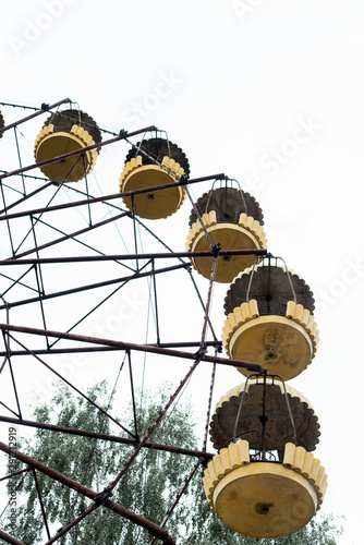 low angle view of ferris wheel in amusement park against sky with copy space