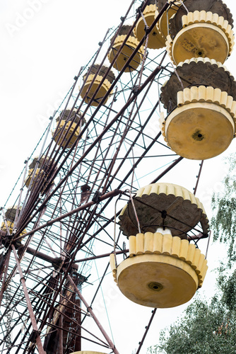 low angle view of ferris wheel in amusement park against sky in chernobyl