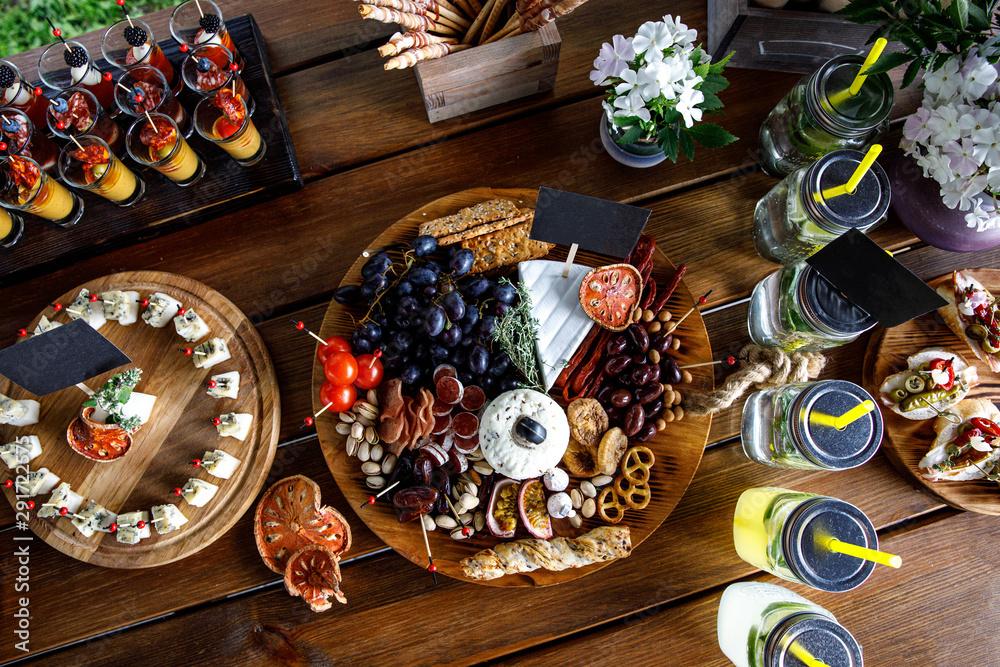 Fototapeta Summer party snacks on wooden table.