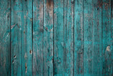 Old teal colored wooden wall