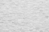 Fototapeta Kamienie - White modern decorative natural stone for inside. Panel wall small marble brick background texture, decorative pattern quartz stone mosaic. interior decoration of the room