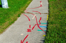 Pattern Of Hydro, Water And Gas Line Markings On A Sidewalk