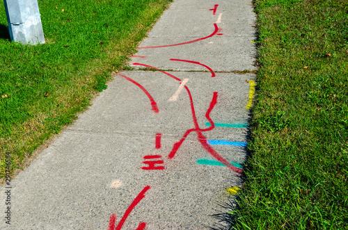 Cuadros en Lienzo  Pattern of hydro, water and gas line markings on a sidewalk