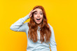 Teenager redhead girl over isolated yellow background has just realized something and has intending the solution
