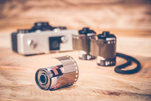 Closeup Of A Film Photography Roll With Vintage Camera. Shallow Depth Of Field. Retro Look Effect.