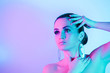 canvas print picture Fashion model with glittering lips and face posing in neon lights