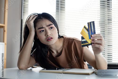 Ταπετσαρία τοιχογραφία Woman is stressed and overthink by debt from many credit cards.
