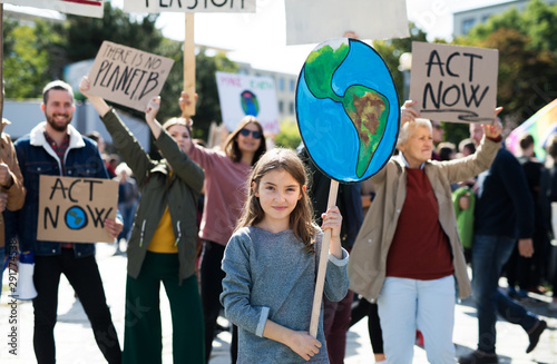 People with placards and posters on global strike for climate change Fotobehang
