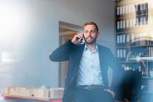 Businessman On Cell Phone In O...