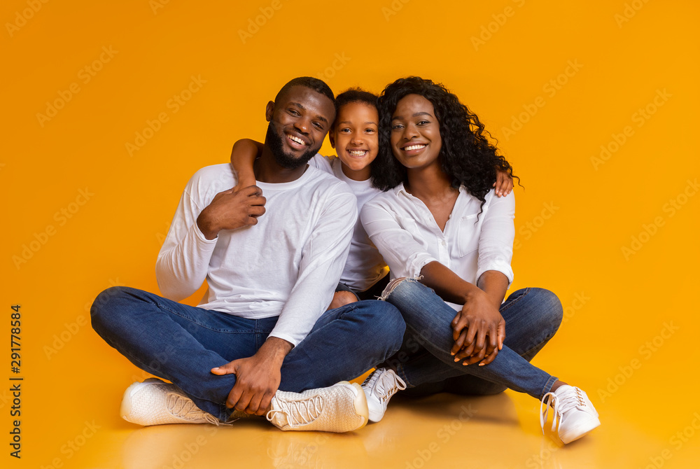 Fototapeta Happy African American Family of Three Over Yellow Background