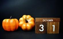 Wooden Calendar On October 31 And Pumpkin On A Dark Background. Halloween Concept, Halloween Background