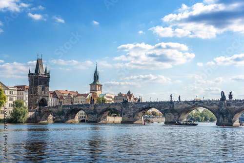 Leinwand Poster View of the city of Prague and the Charles Bridge and Vltava River