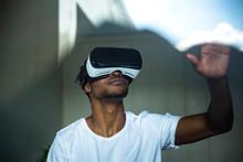 African Man Looking Through VR...