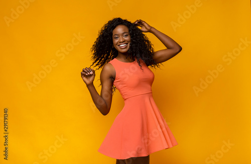 Fényképezés Joyful african girl in summer dress turning around