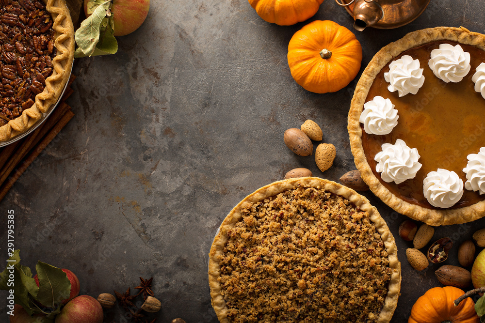 Fotografie, Obraz Traditional Thanksgiving pies with copy space overhead view
