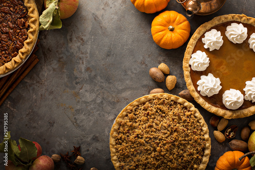Fototapeta Traditional Thanksgiving pies with copy space overhead view