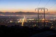 Predawn View Of Power Lines En...