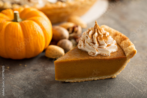 Fotografie, Obraz Traditional pumpkin pie topped with whipped cream