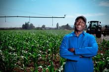 Black Farm Worker Stands Smili...