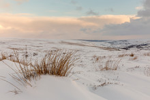 Snow Drift Covered Moorland In The North York Moors National Park. View Looking In To Rosedale At Sunset.