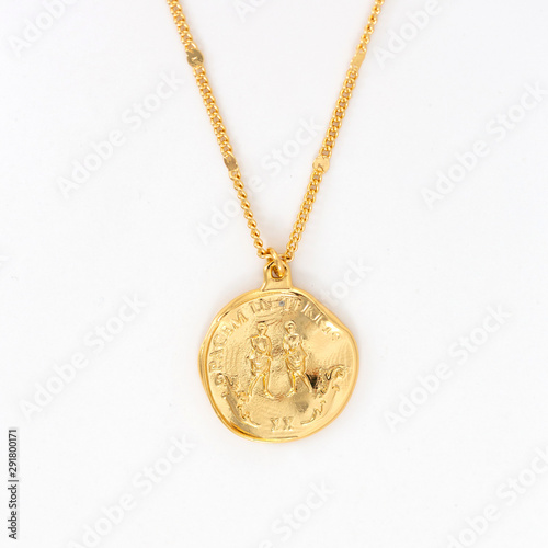 Fotografie, Obraz Vintage gold pendant necklace on gold chain, isolated