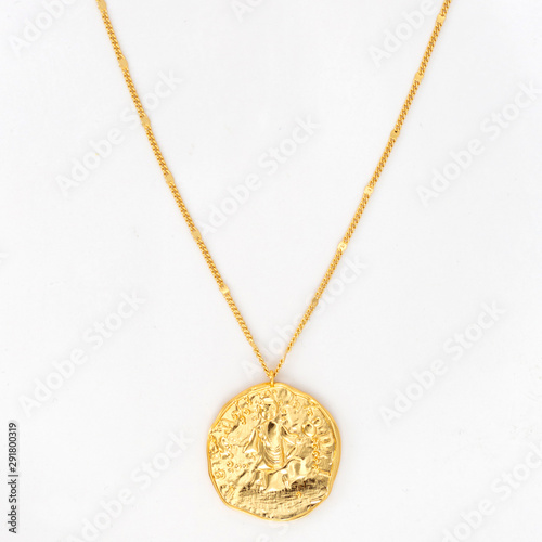Fototapeta Vintage gold pendant necklace on gold chain, isolated