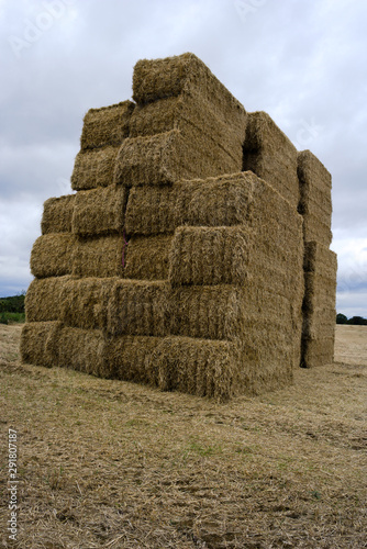 Fotografering Stack of hay bales in east anglia, uk