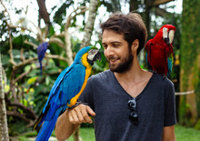 Young Man In The Bird Park