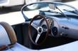 Vintage retro car interior, close-up. Old automobile steering wheel