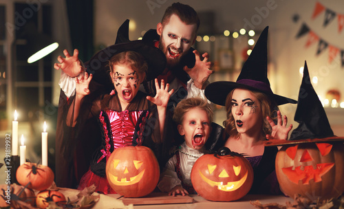 Canvas Prints Textures happy family mother father and children in costumes and makeup on Halloween.