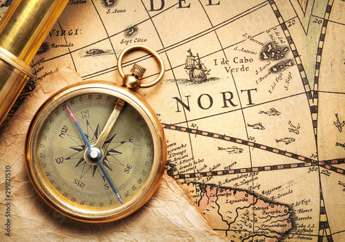 Valokuvatapetti antique compass and spyglass on ancient map by H