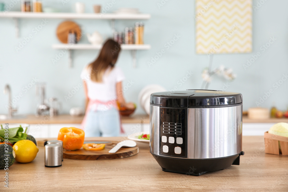 Fototapety, obrazy: Modern multi cooker and products on kitchen table