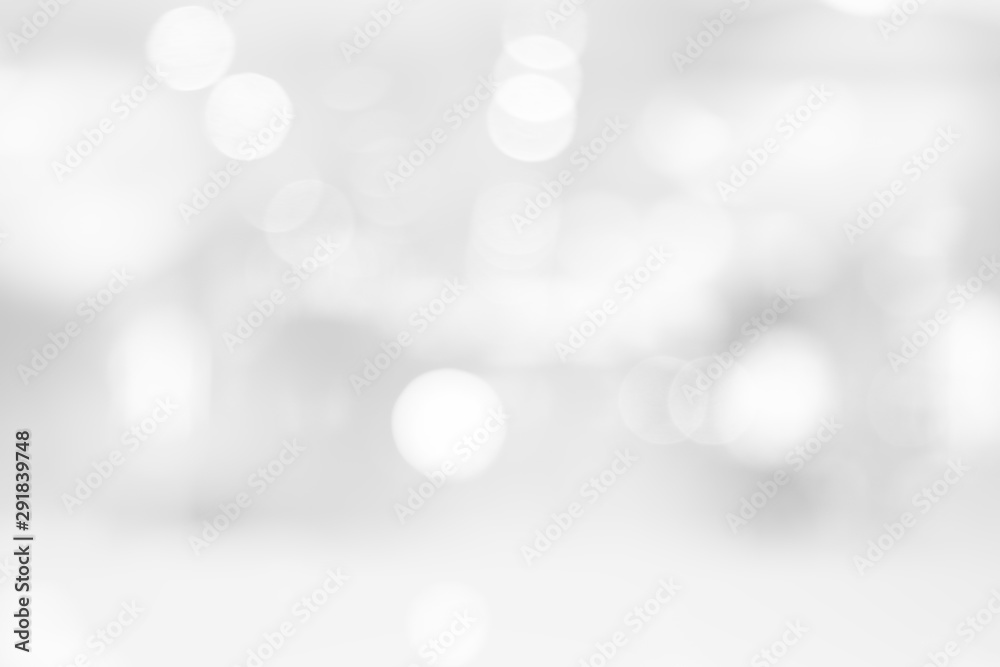 Fototapeta Abstract black and white bright bokeh background with white table top for backdrop design, bokeh composition for , website, magazine or graphic for commercial campaign design