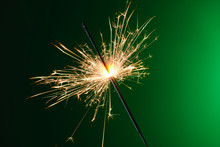 Christmas Sparkler On Color Ba...
