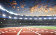 Athlete Running Track With Number On The Start In A Stadium . Evening Scene .