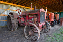 Old Farm Tractor In A Shed
