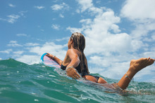 A Young Happy Woman Surfing