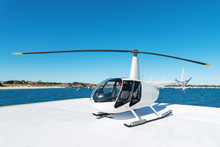 Small Helicopter On Helipad