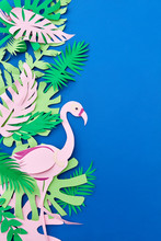 Summer Blooming Handmade Frame From Multicolored Pink, With Tropical Leaves And Flamingo On A Blue Background. Top View.